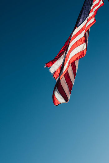 American united state usa flag waving in the blue sky