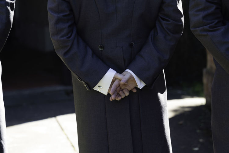 'Nervous Groom' Apprehension Ceremony Close-up Contemplation Day Groom Hands Behind Back Holding Human Hand Marriage  Men Midsection One Person Outdoors Standing Wedding