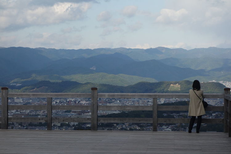 Adult Adults Only Cloud - Sky Coin-operated Binoculars Day Looking Mountain Mountain Range One Person One Woman Only Outdoors People Railing Real People Rear View Sky Standing Telescope Travel Destinations