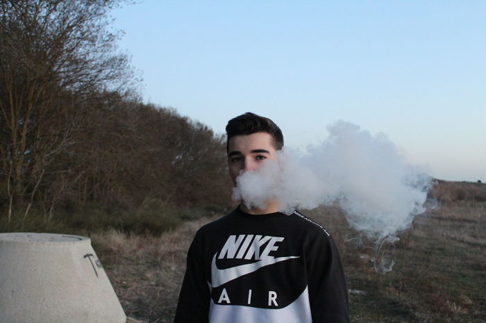 Nike Boy❤ Boy Men Nike Nike✔ Nike Air  Vapour Vapor Vapor Trail Smoke One Man Only One Person Only Men Waist Up Adult Adults Only Portrait Standing People Looking At Camera Outdoors Day Attitude Sky Politics And Government