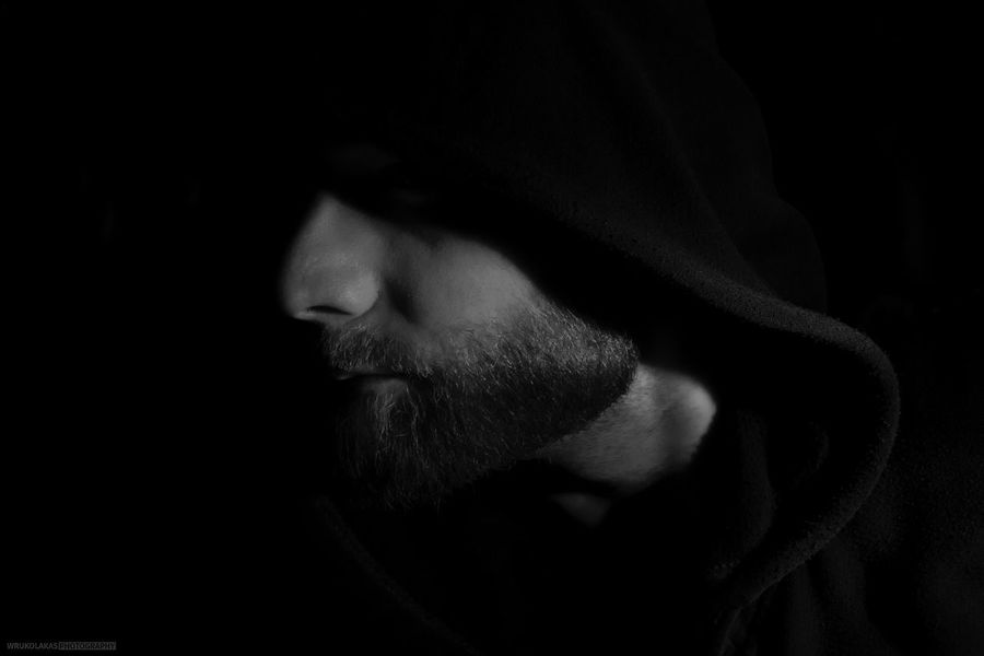 In the Dark One Person Headshot Portrait Indoors  Black Background Studio Shot Close-up Dark Human Face Adult Human Body Part Real People Body Part Clothing Men Emotion Hood - Clothing