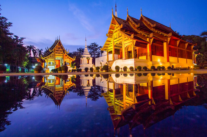 Night temple Wat Phra Singh Woramahawihan, Chiangmai, Thailand Wat Phra Singh Woramahawihan Architecture Building Exterior Built Structure Day History Nature No People Outdoors Place Of Worship Reflection Religion Sky Spirituality Travel Destinations Water Waterfront