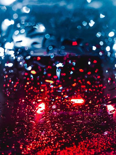 Water Droplets On Car EyeEmNewHere Texture Blue Teal Red Red And Teal Teal And Red Bokeh Water Droplet Car Wash Illuminated Red Night Water Drop Backgrounds Glass - Material Wet No People Window Rain Car Windshield Transparent RainDrop
