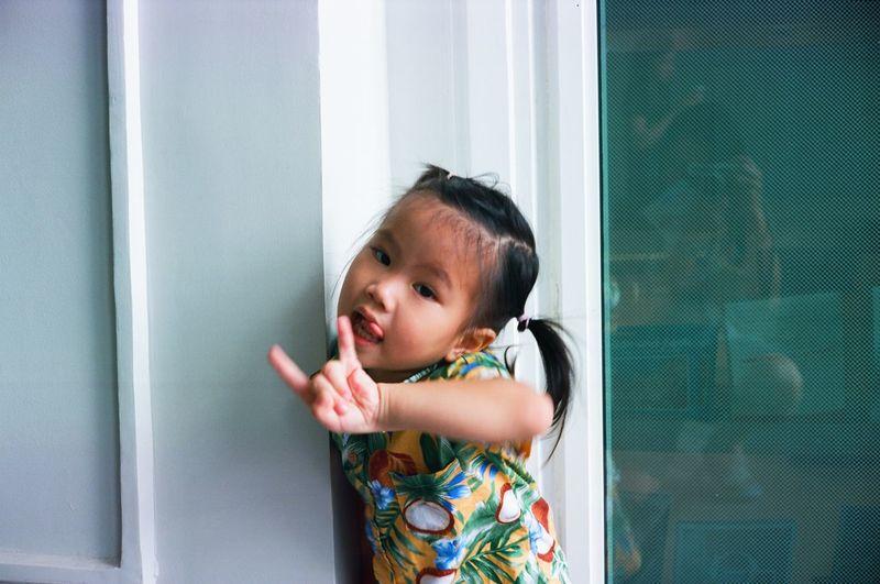 Portrait of cute girl standing in corridor