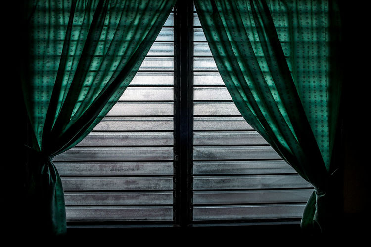 Green curtains on window