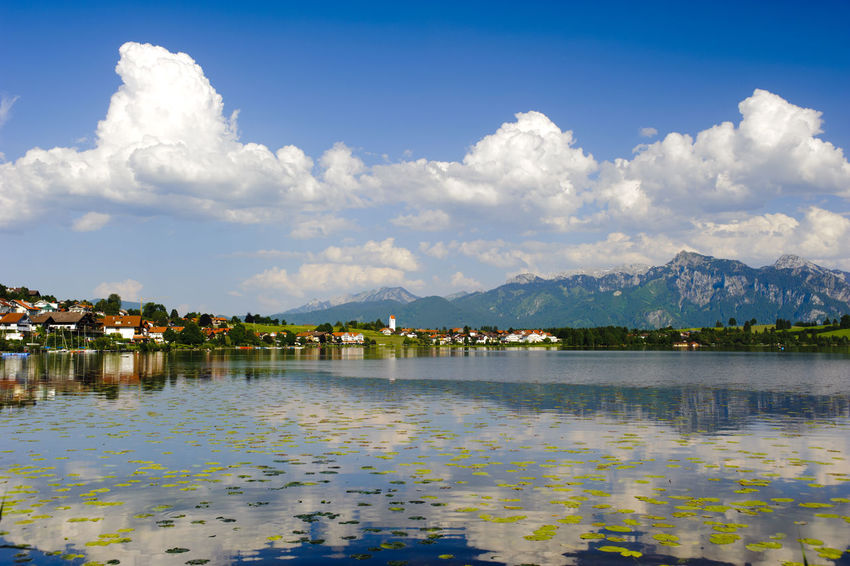 mountain range mirroring in lake Hopfensee nearby city Füssen in Allgäu region, bavaria, Germany Allgäu Bavaria Füssen, Bayern, Deutschland Hopfensee Scenic Water Reflections Beauty In Nature Clouds And Sky Lake Lakeside Landscape Mountain Mountain Range Nature No People Outdoors Reflection Reflection_collection Scene Scenics Sky Summer Tranquil Scene Travel Destinations Water