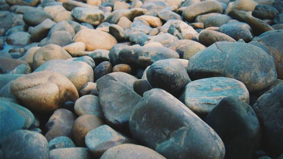 Full frame of pebbles on shore