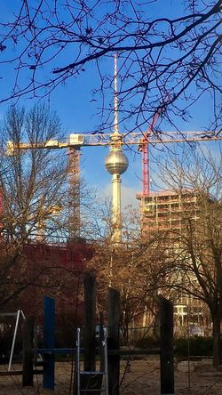 Crane Framed TV Tower Iapaward Compostion Look Through Construction Site Crane Framed Landmark Sight TV Tower Built Structure Architecture Sky Tree Tower No People Day City Tall - High Outdoors Tourism Low Angle View