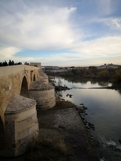 Puente Romano De Mérida Bridge Roman Bridge Photography Cordoba Spain Guadalquivir Guadalquivir River Guadalquivir Cordoba Atardecer Al Caer La Tarde On Sale Monument Redefining Menswear Water Ancient Civilization Ancient History Business Finance And Industry Reflection Sky Architecture Built Structure Civilization Ancient Rome Old Ruin Archaeology The Past Ancient History Ruined