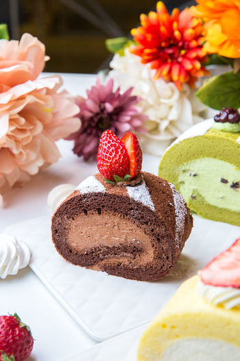 Close-up of cake on flowers