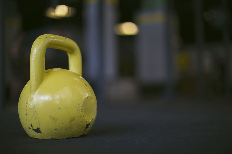 Close-up Crossfit Fitness Focus On Foreground Gym Kettlebell  Sport Yellow