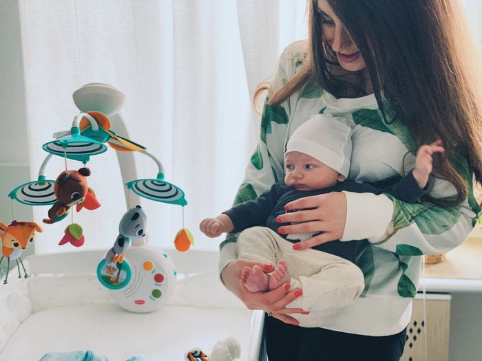Indoors  Childhood Child Family Real People Lifestyles Baby Toy Togetherness Representation Young Casual Clothing Leisure Activity Mother People Home Interior Parent Innocence Hairstyle Son Newborn