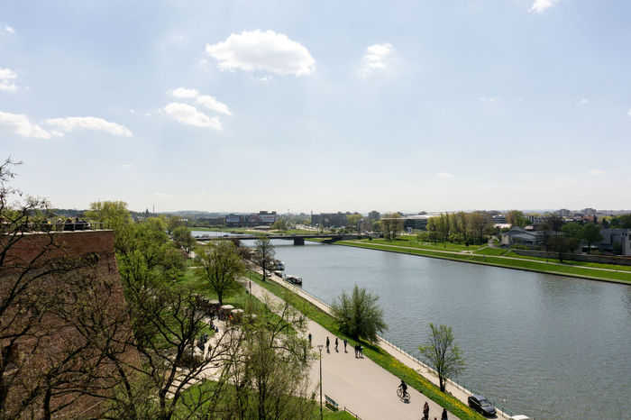 Reached the end of our walking tour / View from Wawel Castle Architecture Bridge - Man Made Structure Built Structure Calm Canal City Cityscape Cloud Cloud - Sky Day Distant Nature Outdoors River Riverbank Scenics Sky Tourism Tranquil Scene Tranquility Travel Destinations Tree Vacations Water Wide