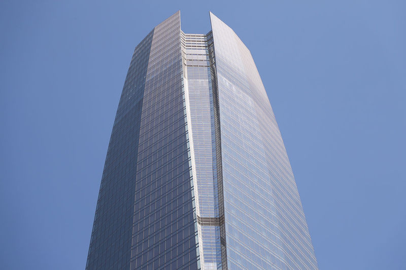 Building Exterior Built Structure Architecture Office Building Exterior Low Angle View Modern Building Skyscraper Clear Sky Sky City Tall - High Office Tower No People Day Nature Blue Travel Destinations Outdoors Spire  Financial District