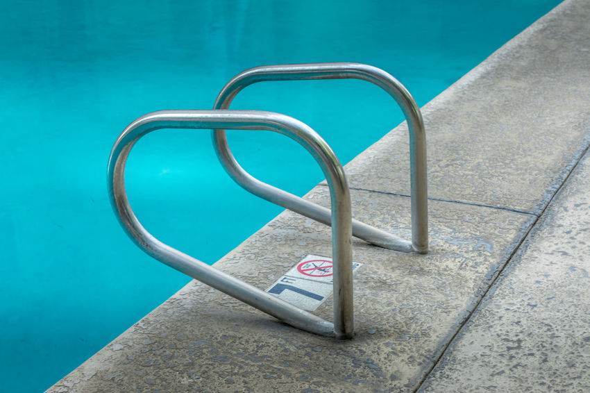 Freshness Blue Close-up Communication Day High Angle View Ladder Leisure Activity Metal No People Number Outdoors Pool Poolside Railing Refreshing Safety Shape Silver Colored Sport Still Life Summer Swimming Pool Text Turquoise Colored Water