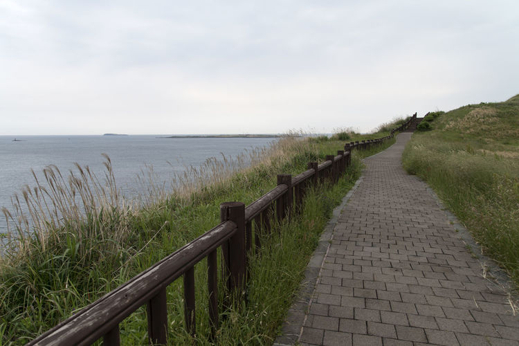 landscape at Songaksan in Jeju Island, South Korea Beauty In Nature Day Footpath Grass Horizon Over Water JEJU ISLAND  Nature No People Outdoors Scenics Sea Seaside Sky Songaksan The Way Forward Tranquil Scene Tranquility Water