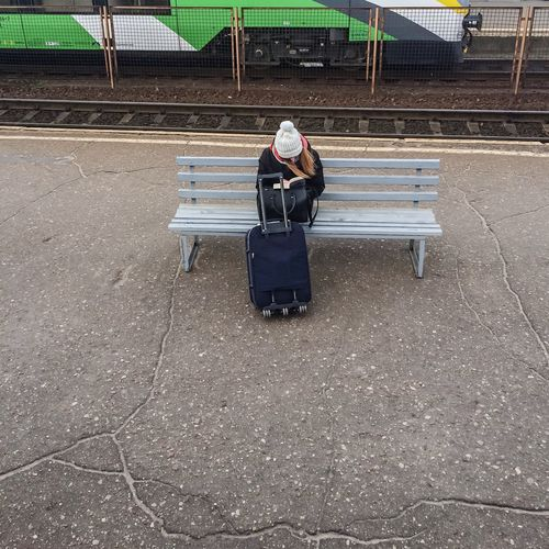 Girl reading book at the platform Reading Reading A Book Platform Girl Paperbook Traveling & Reading Waiting For A Train
