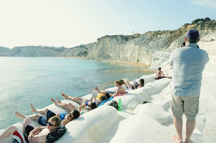 Staring at the sun Italy Scala Dei Turchi Beachphotography Life Is A Beach Sun_collection People Colected Comunity Ocean View Oceanlife Travel Photography The Tourist Pastel Power Feel The Journey