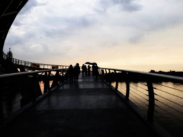 EyeEmNewHere Bridge Bridge - Man Made Structure Built Structure Cloud - Sky Group Of People Leisure Activity Outdoors Real People Sky Sunset Walking