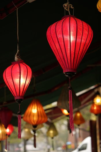 Lighting Equipment Illuminated Hanging Lantern Decoration Celebration No People Chinese Lantern Low Angle View Night Red Focus On Foreground Indoors  Electricity  Glowing Architecture Holiday Light Ceiling Electric Lamp Chinese Lantern Festival Chinese New Year