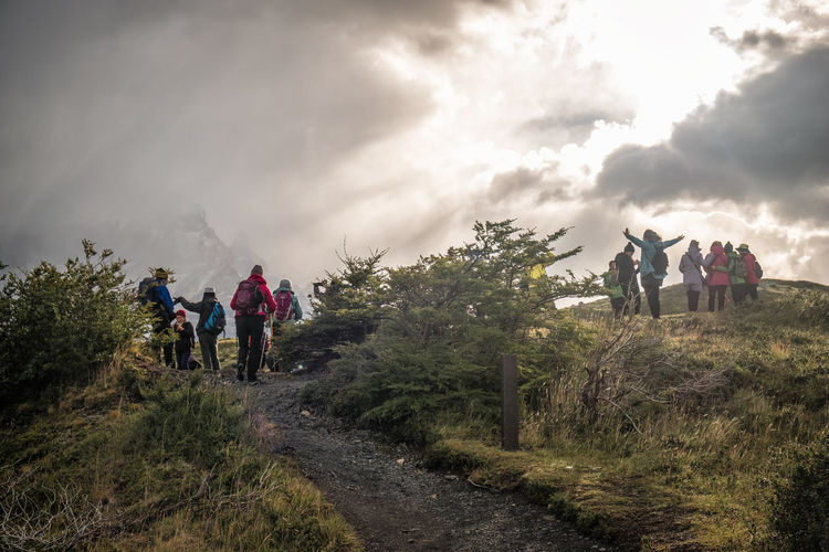 Adventure Backpack Cloud - Sky Group Group Of People Hiking Leisure Activity Lifestyles Medium Group Of People Men Mountain Nature Outdoors People Plant Real People Sky Travel Tree Walking