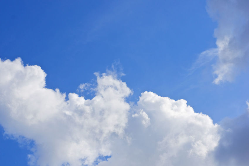 White cloud on left bottom of blue sky as a background. Atmosphere Beautiful Cloud Heaven High Peace Scenic Weather Air Background Blue Climate Cloudscape Cumulus Day Daylight Meteorology Moisture Nature Nebulosity Outdoor Season  Sky Tranquility White
