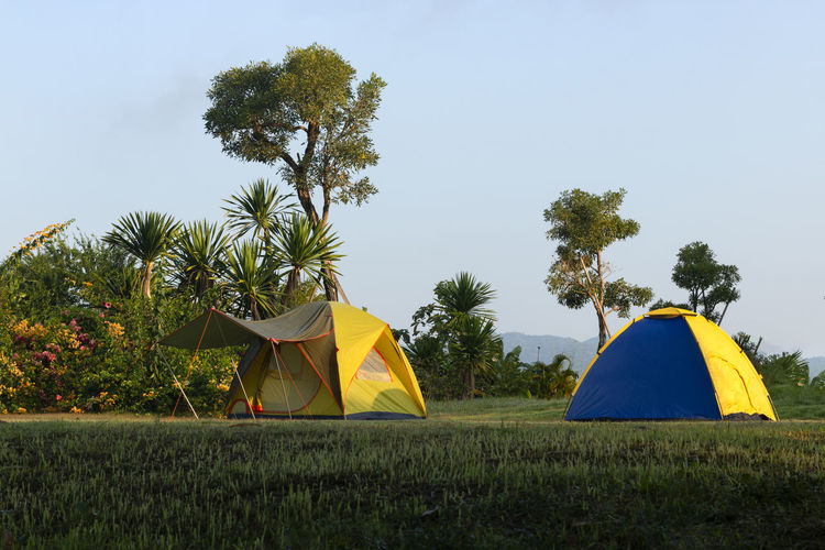 Tent on field against clear sky