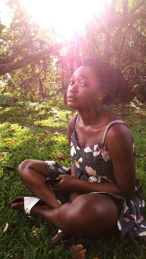 Young Women Young Adult Tree Sunlight Casual Clothing Sunbeam Relaxation Leisure Activity Sitting Lifestyles Grass Person Holding Looking Down Full Length Growth Beauty Nature Outdoors Beauty In Nature South Africa Calm Africa Lost Stare Back At You...