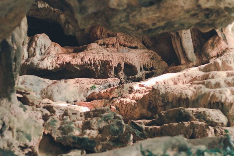 Uthai Thani - Thailand : Tropical forest rock cave travel in nature concept. Travel lifestyle in nature forest. Asian  Casual Excursion Exploring Plant Relexing Tourist Travel Visual Creativity Advanture Attractive Backpack Cave Journey Jungle Landscape Mountain Rock Rock Formation Stone Tourism Vacation Valley
