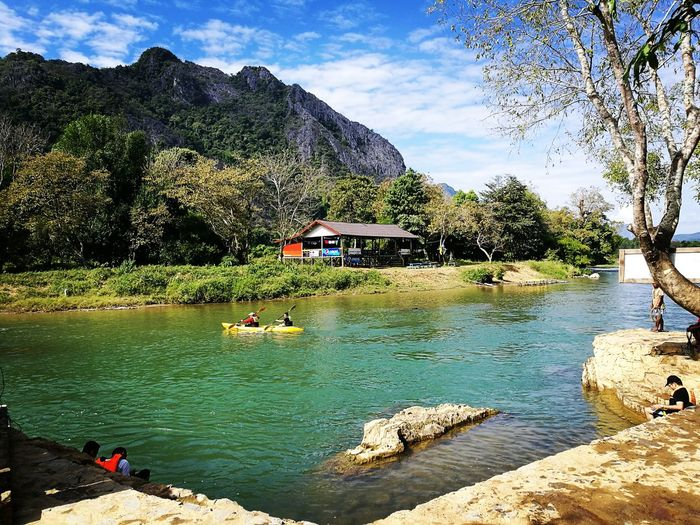 Water Sky Nature Tree Outdoors Beauty In Nature Vangvieng,Laos Songriver Reflection Scenics Lake No People Cloud - Sky Day Tranquility Reflection Lake Bridge - Man Made Structure Stream - Flowing Water First Eyeem Photo
