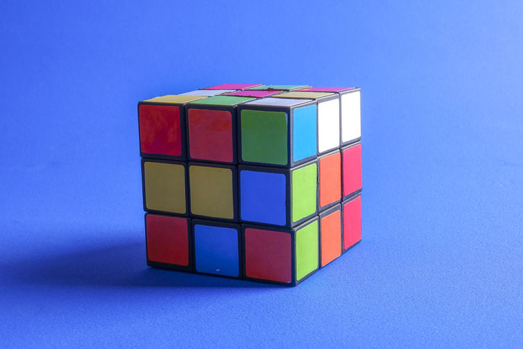 RUBIK'S CUBE , CREATIVITY TOY Creativity Rubik Cube Blue Blue Background Close-up Colored Background Copy Space Cube Shape Cut Out Design Geometric Shape Indoors  Intelligence Large Group Of Objects Multi Colored No People Puzzle  Rubik Shape Stack Still Life Studio Shot Toy Toy Block