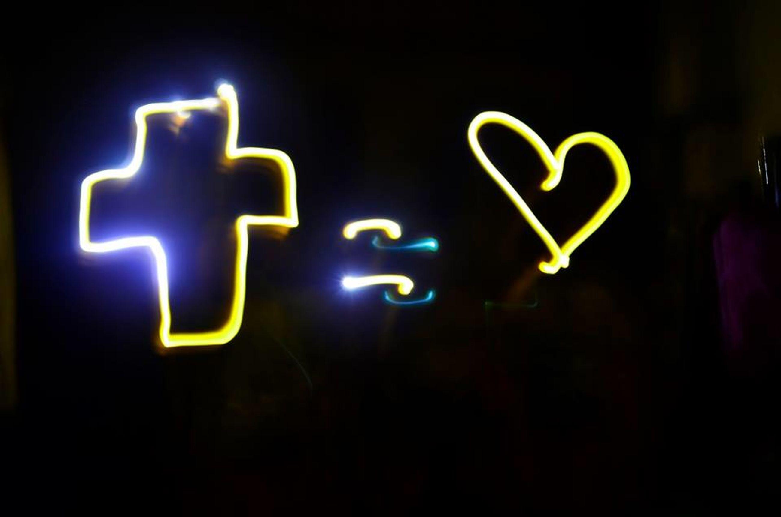 illuminated, text, western script, communication, night, close-up, human representation, capital letter, neon, indoors, glowing, black background, art and craft, creativity, art, sign, symbol, studio shot, ideas