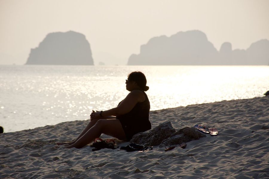 Beach life Beach Beauty In Nature Full Length Horizon Over Water Land Leisure Activity Lifestyles Looking At View Nature One Person Outdoors Real People Rear View Relaxation Rock Scenics - Nature Sea Sitting Sky Vacations Water