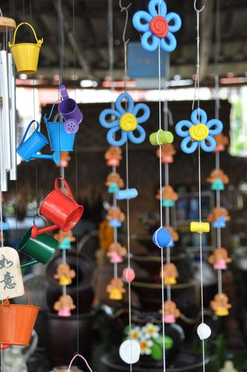 Close-up of toys for sale at market stall
