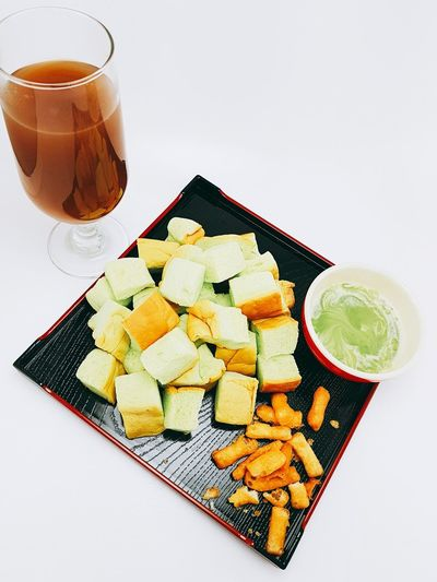 Ginger juice and backing bread Green Milk Jam Backing Bread  Ginger Juice White Background Studio Shot Fruit Comfort Food Archival Close-up Food And Drink Served Serving Size Ready-to-eat Plate