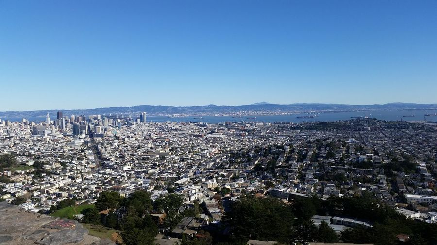 High angle view of cityscape against clear blue sky