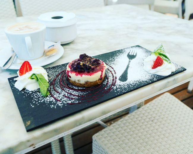 Dessert on slate over table