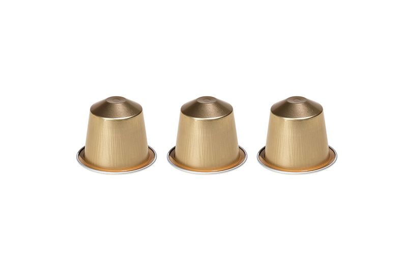 Three golden coffee capsules isolated on white background Aroma Close-up Cofee Coffee Coffee Break Coffee Capsules Coffee Time Italian Nespresso Nespresso... What Else…? No People Three Volluto White Background