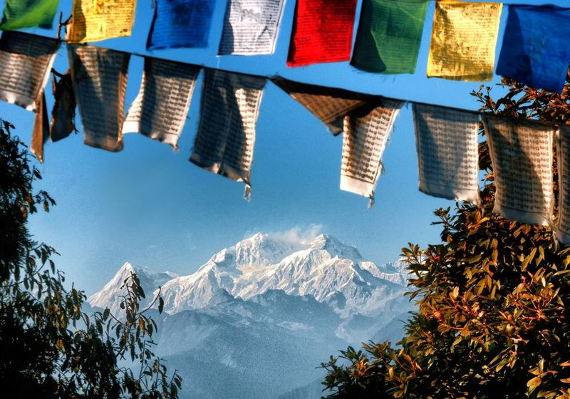Mt. Kabru from the Pemyangtsey Monastery near Pelling, Sikkim, India. Travel Destinations Outdoors Flag Sky No People Himalayas Tranquil Miles Away Travel Photography Peaceful Tranquility Nature Sunlit Traveller Beauty In Nature Mountain Peak Mountain Range Mountain Serene Travel Scenics