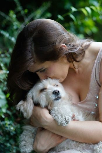 Young woman and her dog Animal Themes Bonding Close-up Closeness Cute Dog Domestic Animals Eyes Closed  Friendship Love Maletese Mammal One Animal One Person Outdoors People Pet Photography  Pets Portrait Real People Trust