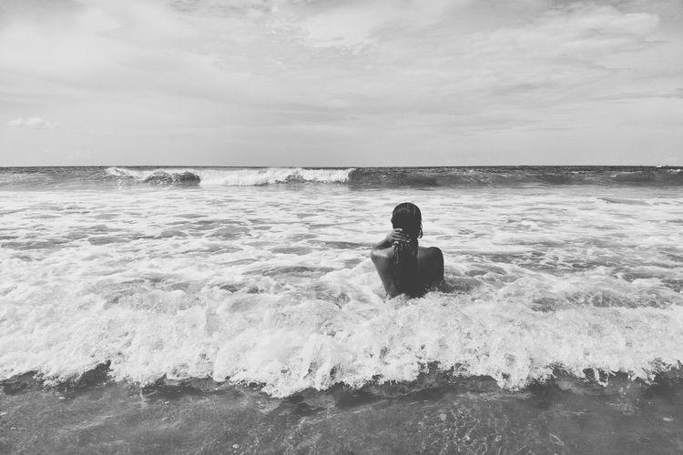 Full length of man on sea against sky