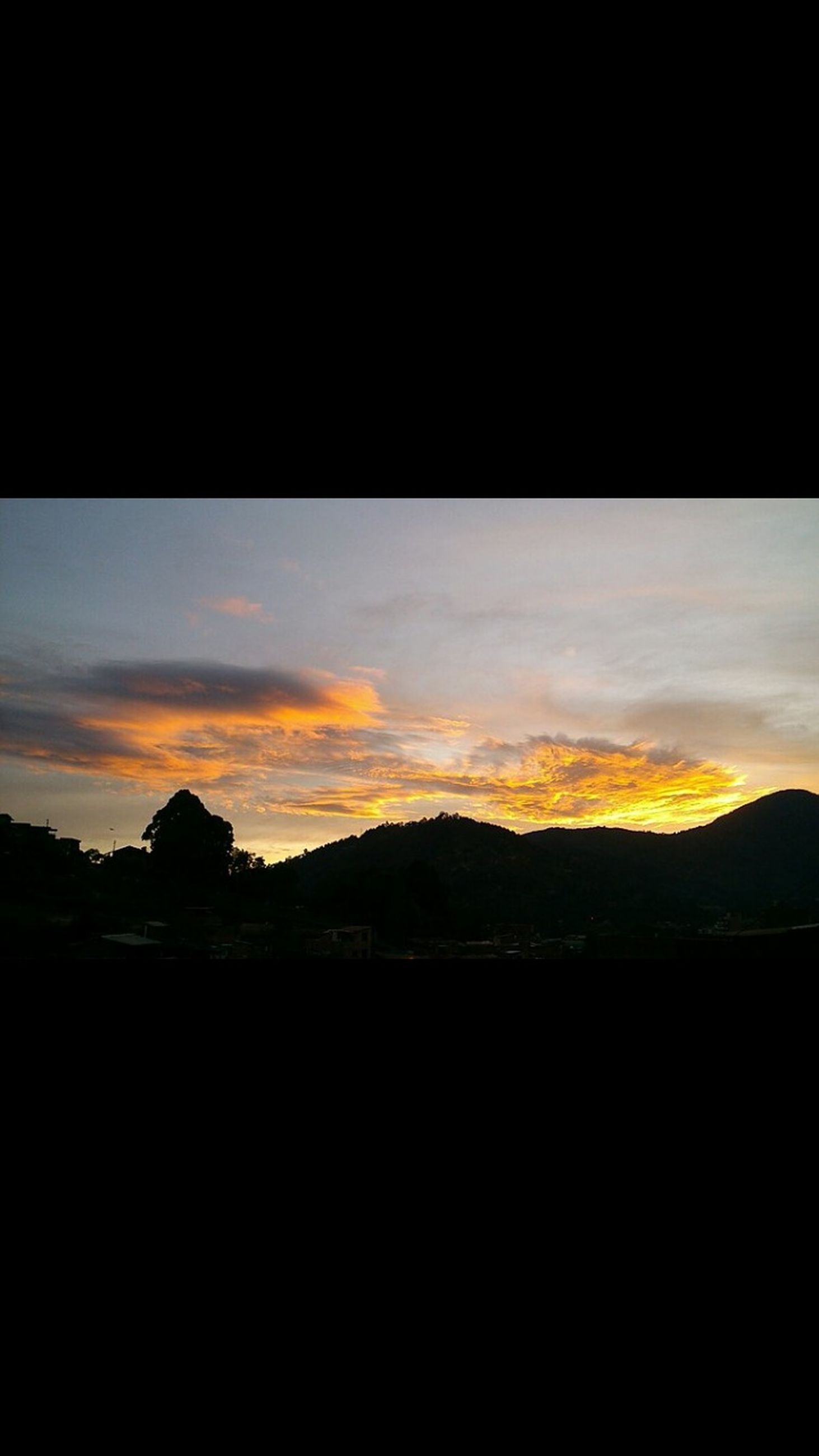 silhouette, sunset, scenics, sky, dark, tranquil scene, beauty in nature, tranquility, copy space, nature, landscape, orange color, idyllic, cloud - sky, dusk, mountain, cloud, no people, outline, outdoors