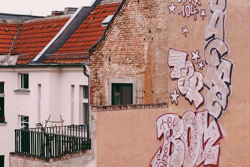 Balcony & Graffiti. Architecture Balcony Berlin Berlin Photography Berliner Ansichten Brick Brick Wall Building Exterior Built Structure Day Graffiti No People Outdoors Prenzlauerberg Roof Rooftop Sky Streetart Streetphotography Wall Window