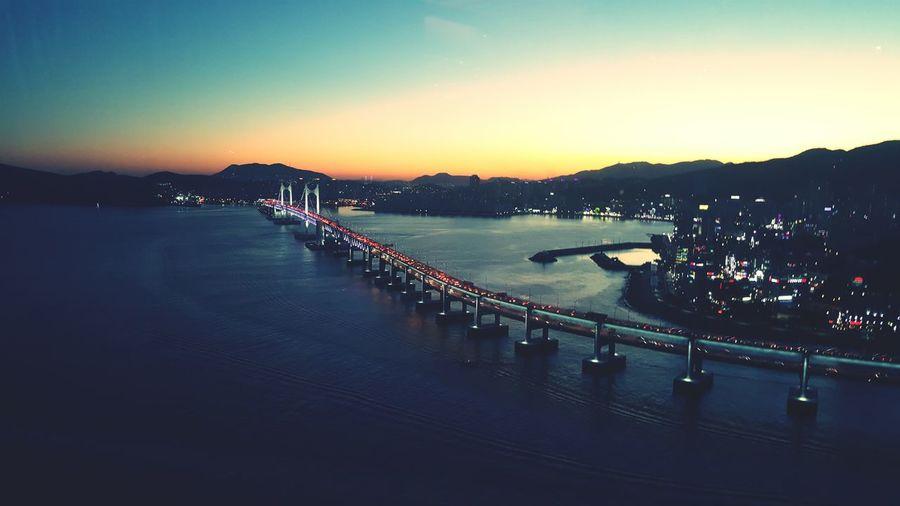 High angle view of gwangandaegyo bridge over river at sunset