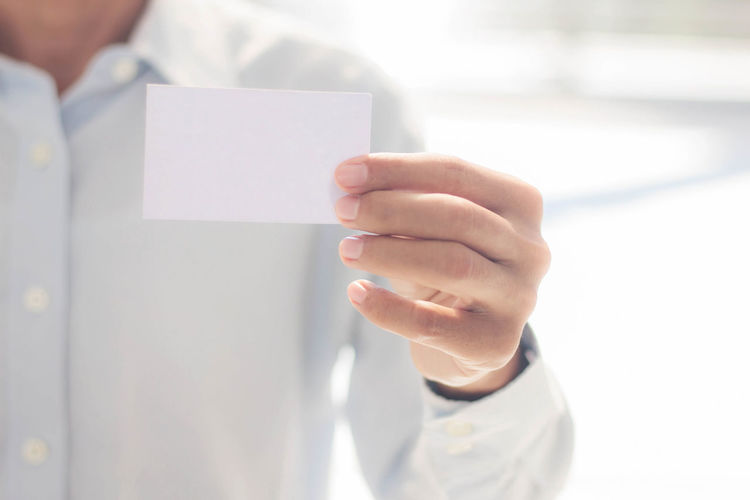 Adult Blank Close-up Copy Space Doctor  Focus On Foreground Front View Hand Healthcare And Medicine Holding Human Body Part Human Hand Indoors  Midsection Occupation One Person Paper Selective Focus White Color Women