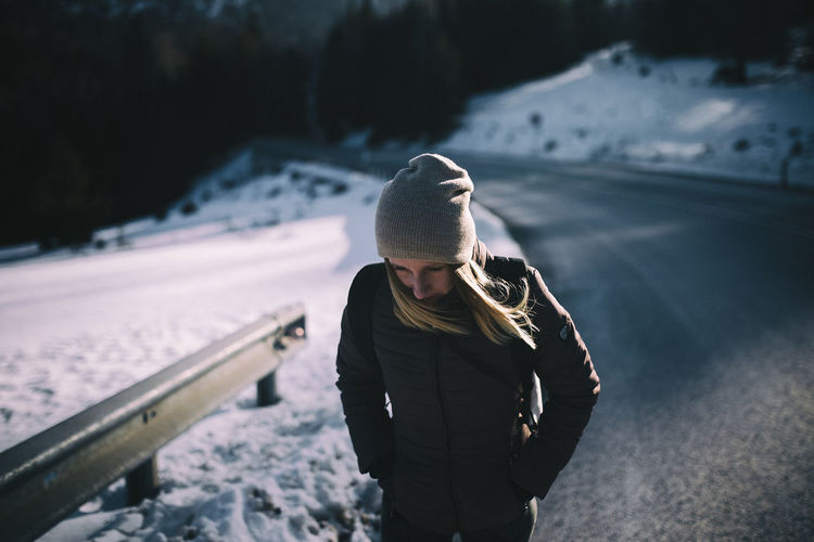 Woman wearing hat in snow