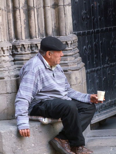 Begging Adult Barcelona Begging Cathedral Church City Composition Flat Cap Full Frame No Incidental People One Man Only One Person One Senior Man Only Outdoor Photography Portrait Senior Adult Sitting Social Issues Spaın Sunlight