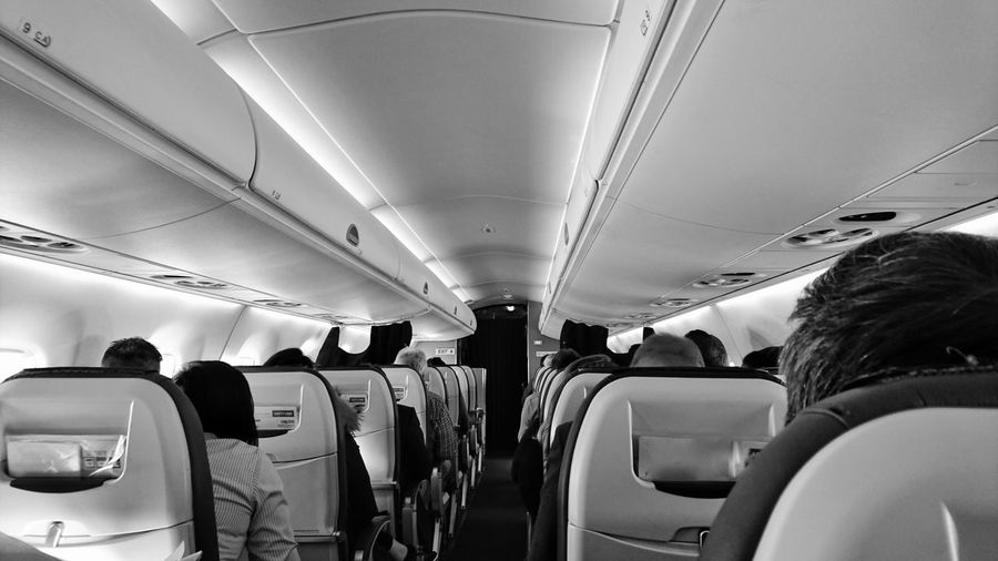 People sitting on seats in airplane