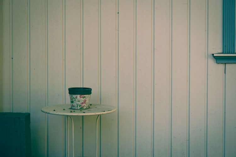View of empty table against wall
