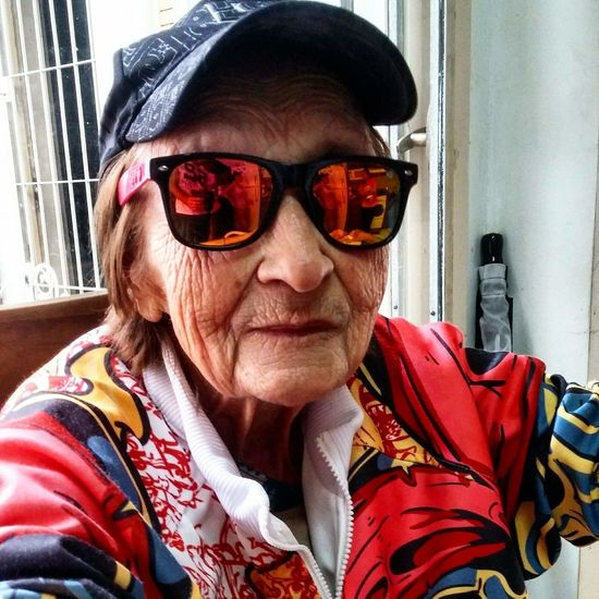 Abuela One Woman Only One Person Only Women Adult Senior Adult Sunglasses Headshot Adults Only People Senior Women One Senior Woman Only Portrait Front View Looking At Camera Day Eyeglasses  Retirement Sitting Red Gray Hair Buenos Aires Argentina